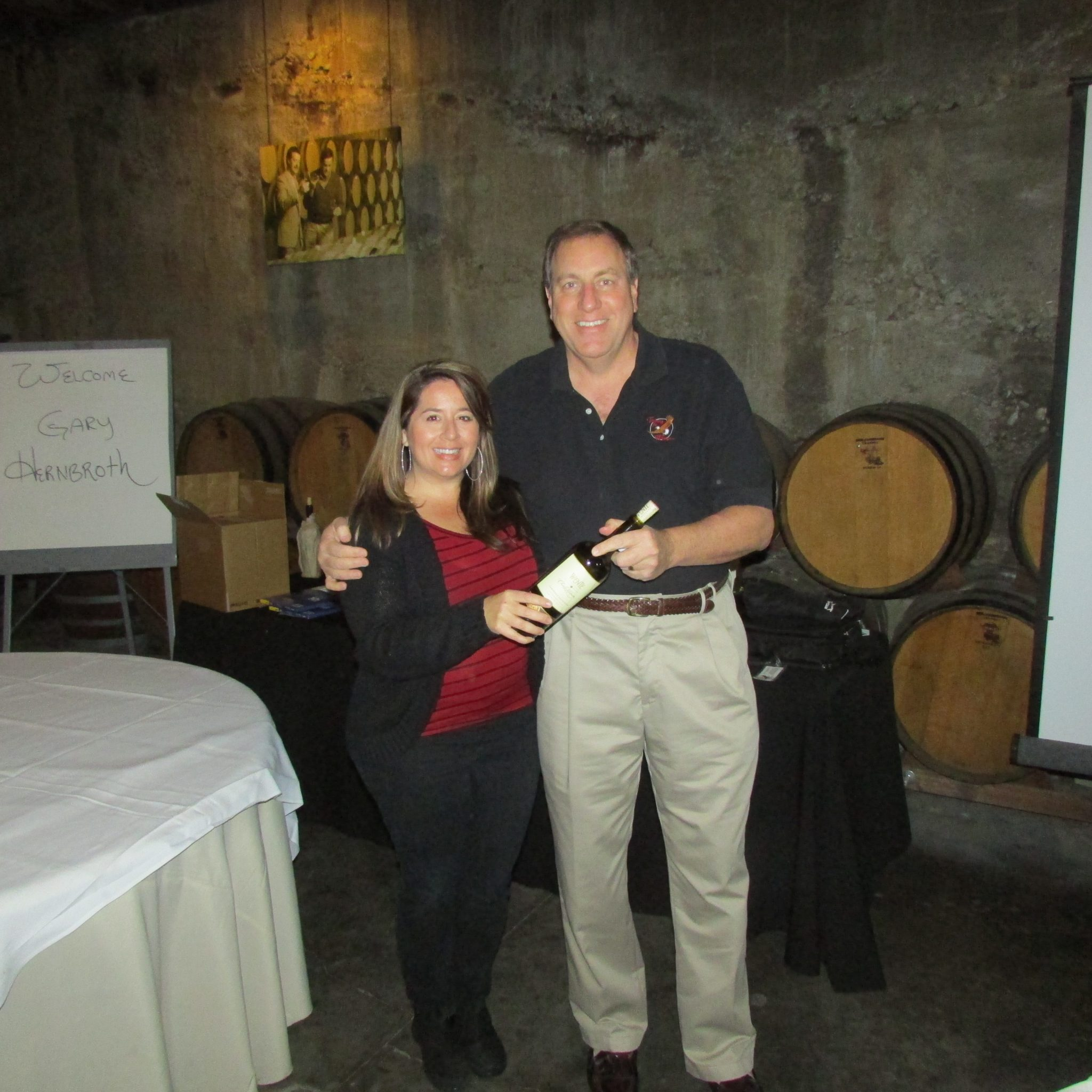 Wente Vineyards presents Gary with an excellent vintage after his sales training workshop in their barrel room