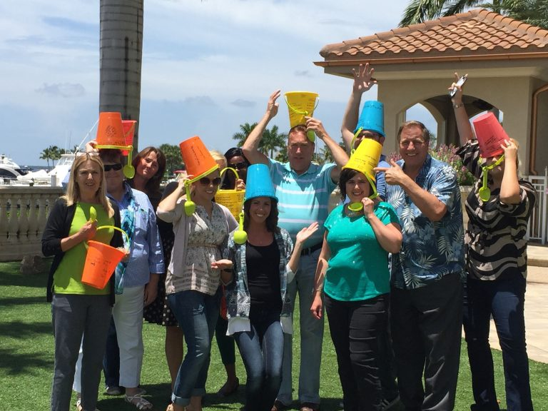 "The Lee County (Fort Myers-Sanibel, FLA) CVB sales team shows off their buckets that Gary helped them fill with ""bucket list ideas"" for driving sales"